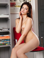 New model Carisse shows off her nubile body on the chair.