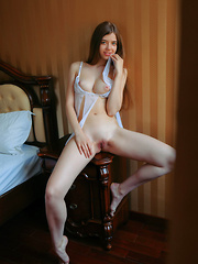 Kay J sensually poses with her sexy lingerie on the bed.