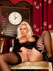 Well-looking blonde mom in black stockings