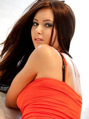 Sexy Natasha in orange top  and tight jeans
