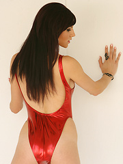 Autumn is smokin hot in her super sexy, shiny red one piece
