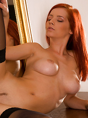 Burring hot redhead feels her own curves and sensitive areas.