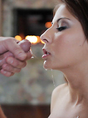 Busty babe gets fucked by fireplace.