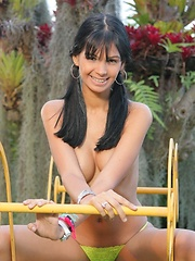 Karla Spice touches her flawless body in her backyard wearing pigtails and a thong