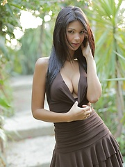 Karla Spice models her little brown dress but soon takes it off