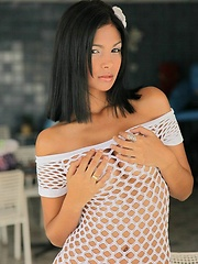 Karla strips down her mesh dress to reveal her perfectly naked body