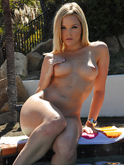 Alexis Texas sheds her bikini and bends over
