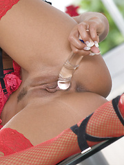 Ashley Bulgari sticks a dildo in and out of her pussy
