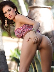 Vanessa Veracruz strips outside showing off her soft skin and shaved pussy.