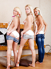 Three fascinating blonde lesbian teen beauties taking off clothes and posing in the nude.