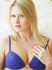 Luscious Lucy Heart looks provocative in her purple bra and panties. She slips out of her lingerie to expose puffy nipples and a smooth pussy.