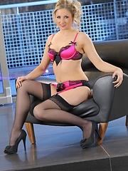 Nikki F in pink satin lingerie.