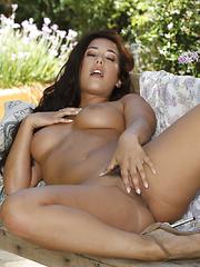Eva Lovia presses her fingers against her aroused clit