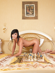 Sexy chess game with brunette