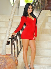 Cornine in a red dress and black panties