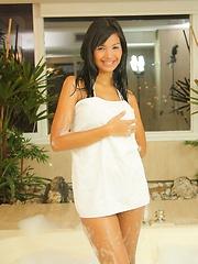 Karla slips off her bikini under the bubbles