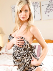 Beautiful blonde shows off her sexy body as she teases her way out of her leopard print dress.