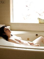 Perky tit brunette fucks her glass dildo in the bath