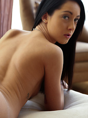 Thin girl with dark hair gets milk bath