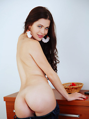Amelie B is a brunette bombshell with undeniably strong erotic and confident personality as she highlights her slender legs, and delicate, pink pussy.