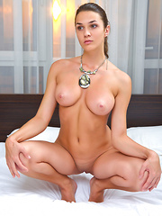 Vanda B confidently showcases her luscious body with gorgeous breasts, well-toned torso, shaven pussy, and pretty feet.