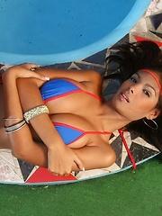 Karla take a dip in a tight micro bikini
