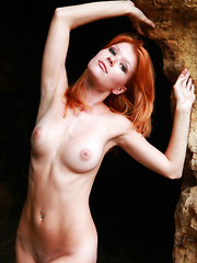 Stunning redhead Mia Sollis flaunts her perfect body and puffy nipples outside.