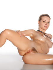 Edwige A  shows off her flexible, oiled up body with wide open poses.