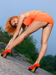 Wearing a body-hugging dress that shows off her sexy curves and sexy orange pumps, Violla A turns an outdoor shoot to a naughty striptease.